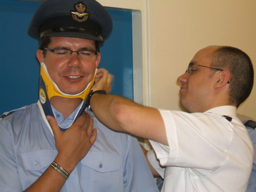 Flt. Lt. Stevens putting Flying Officer blight in a neck brace on a First Aid Training exercise.