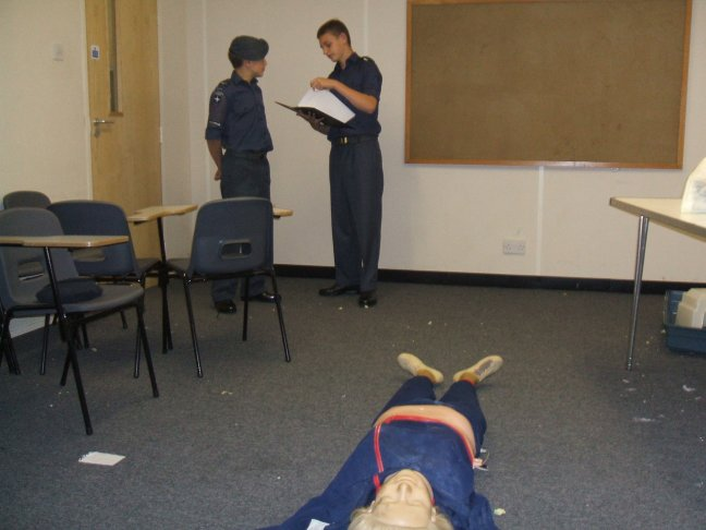 Cpl. Parry briefing Cpl. White for a First Aid exercise.
